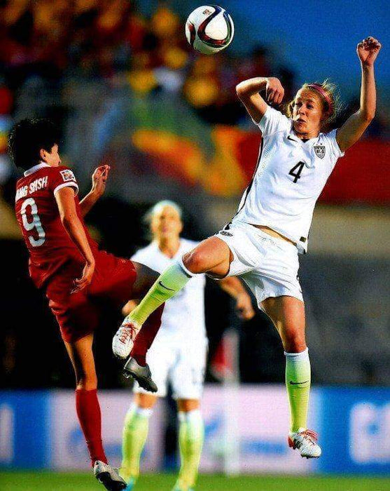 Becky Sauerbrunn in White Heading Ball Unsigned 8x10 Photo