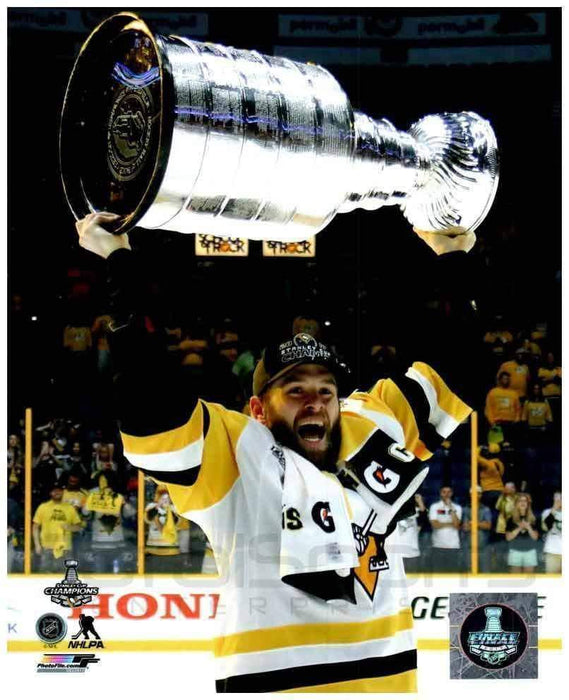Bryan Rust Raising 2017 Stanley Cup Framed 8x10 Photo - Unsigned