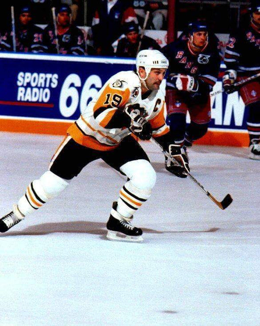 Bryan Trottier Skating in White with Stick Unsigned 8x10 Photo