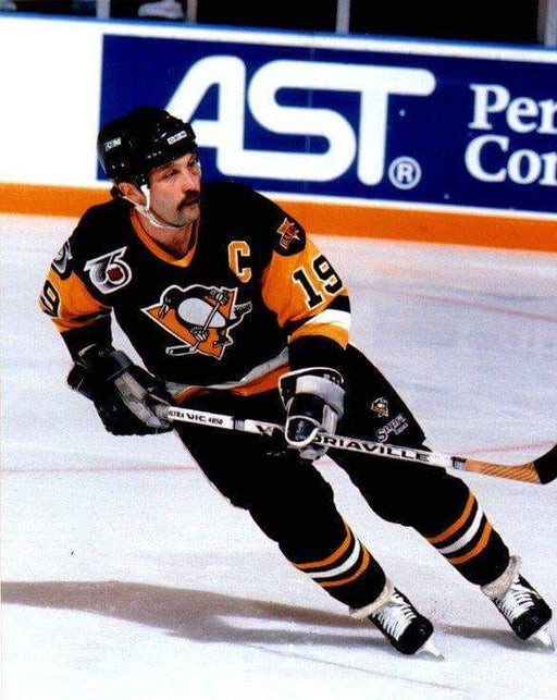 Bryan Trottier Skating with Stick Unsigned 8x10 Photo