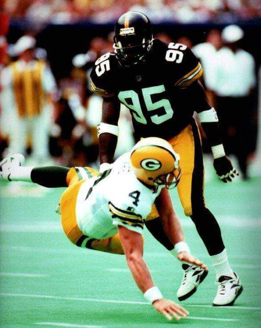 Gregg Lloyd hitting Favre color Unsigned 8x10
