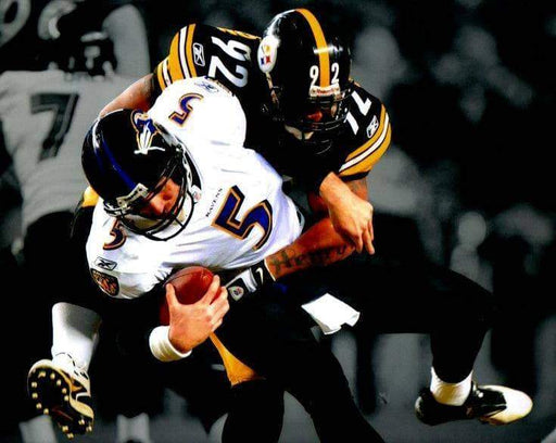 James Harrison Sacking Flacco Spotlight Horizontal Unsigned 8x10 Photo