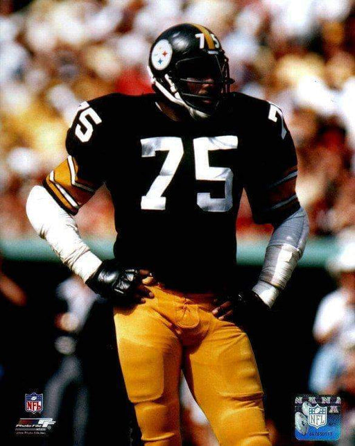 Joe Greene Hands on Hips in Black Jers. Unsigned Licensed 8x10