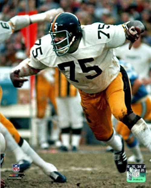 Joe Greene UNSIGNED Attacking in White 8x10 Photo