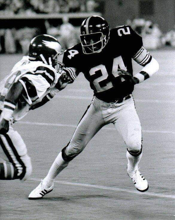 JT Thomas Stiff Arm Eagles in Black Unsigned 8x10 Photo
