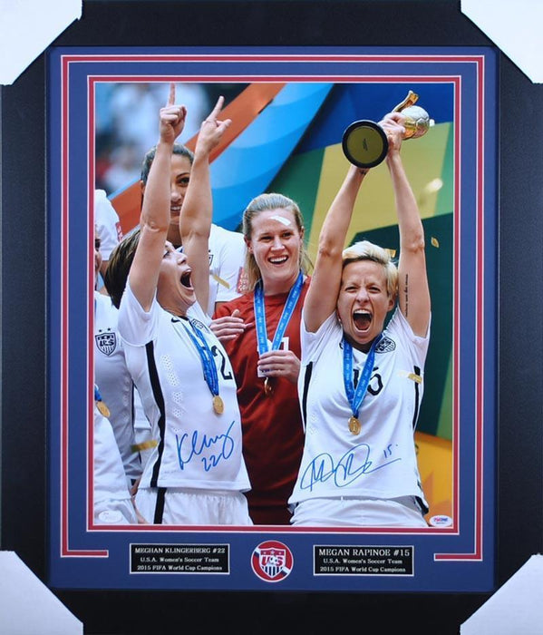 Meghan Klingenberg and Megan Rapinoe Signed Raising Trophy 16x20 - Professionally Framed