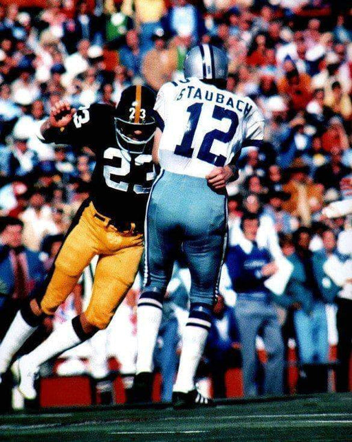 Mike Wagner Tackling Staubach Unsigned 8x10 Photo