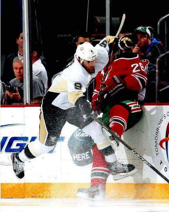 Pascal Dupuis in White Hitting Devils Unsigned 8x10 Photo