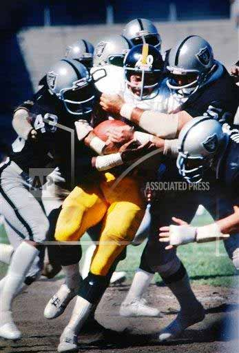 Pre-Sale: Rocky Bleier Signed Vs. Entire Raiders Team Photo