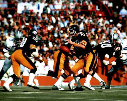 Rocky Bleier Getting Ball from Terry Bradshaw Unsigned 8x10 Photo