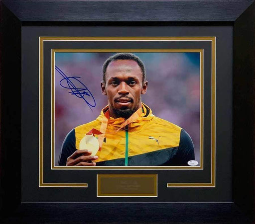 Usain Bolt Autographed Close-up Holding Medal 11x14 - Professionally Framed