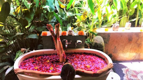 Ayurvedic massage followed by rose petal bath is a must-try wellness treatment in Karsa Spa, Ubud.