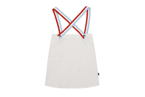 Petit Clair white jumper with red white & blue straps
