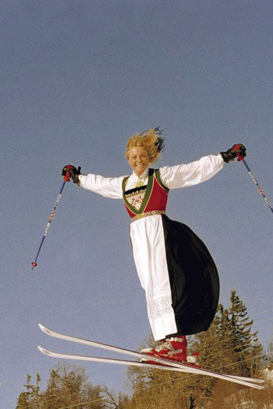 Blonde female skiier in a vintage skiing costume.