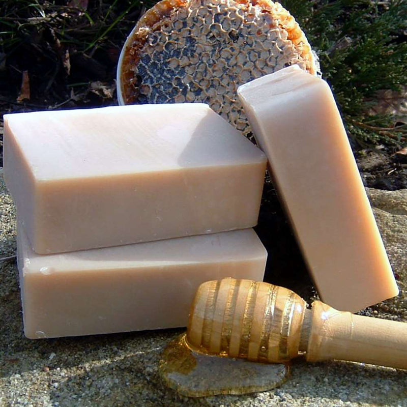 Organic soap bar with honey, cocoa butter to seal in moisture, Shea Butter and Mango Butter to soften, moisturize, and soothe dry skin.