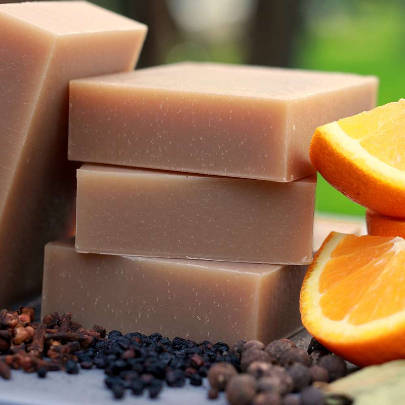 Men's bay rum Organic soap bar with sweet orange, allspice and clove essential oils. Hemp seed oil balances oil production, chicory root and elderberries calm irritated skin.