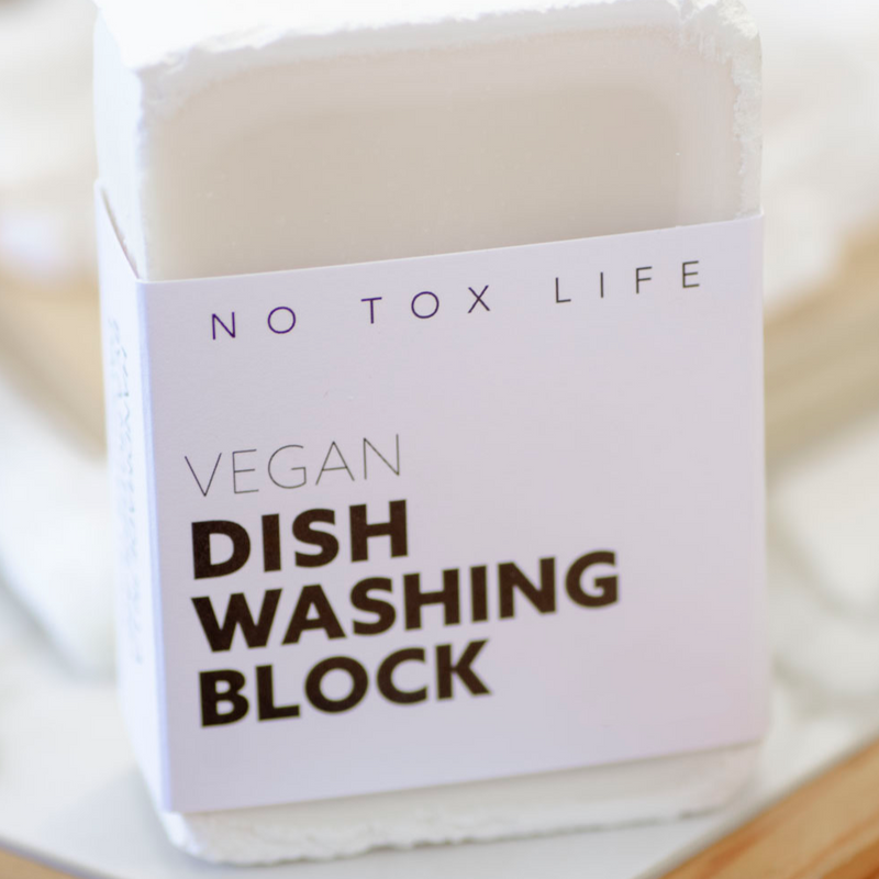 A vegan zero-waste vegan dish block® dish washing soap to cuts stubborn grime and grease, take stains out of laundry, wipe down counters. 215 GR