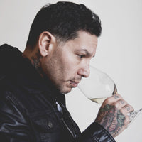 Mike Herrera, savoring Anchor Valley's award-winning 2017 Pinot Gris