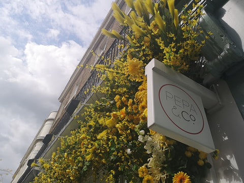 Belgravia in Bloom Pepa & Co. Shop Front Sky Yeloow and White Flowers