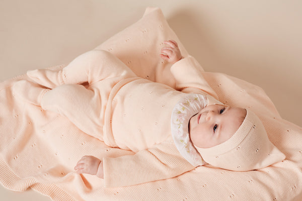 Newborn in Pink Outfit and Bonnet