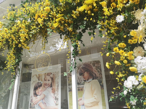 Belgravia in Bloom Pepa & Co. Shop Front White and Yellow Flowers Display