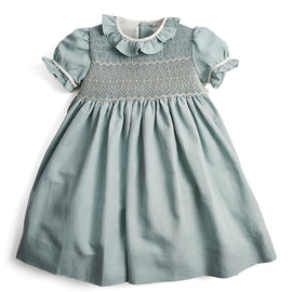 Flower girl's occasion dress in teal with ivory handsmock detail