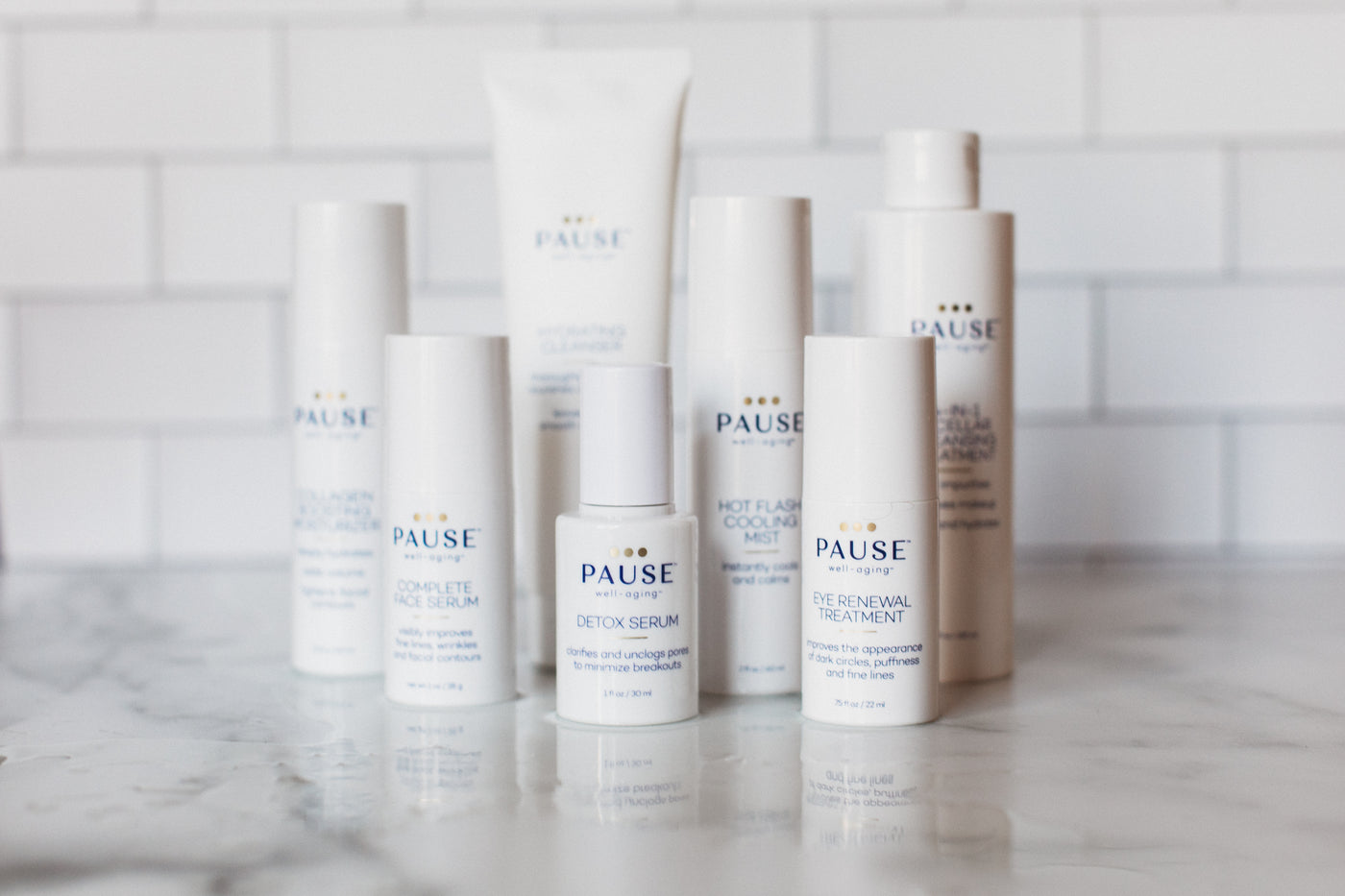 Pause Well Aging Hero Image on the FAQ page showing the full PAUSE skincare collection