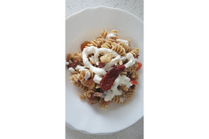 Pasta with stracciatella, sundried tomatoes and fresh tomatoes