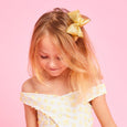 Pixies Bows Dream Tinsel Gold Bow on Little Girl