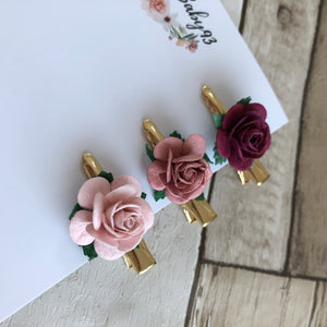 single large rose, small gold clip