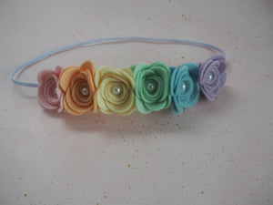 Rainbow rose headband with pearl centre