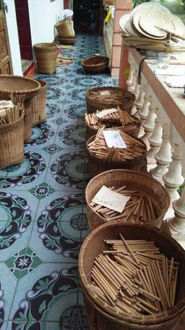 Finished bamboo straws in baskets ready to be packaged.