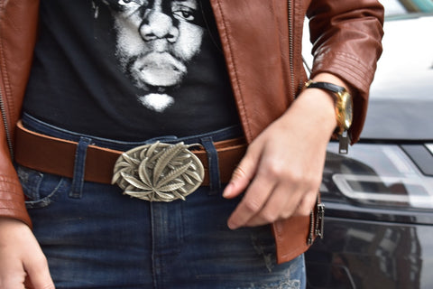 a girl wearing custom leather belt with weed brass buckle in vintage style