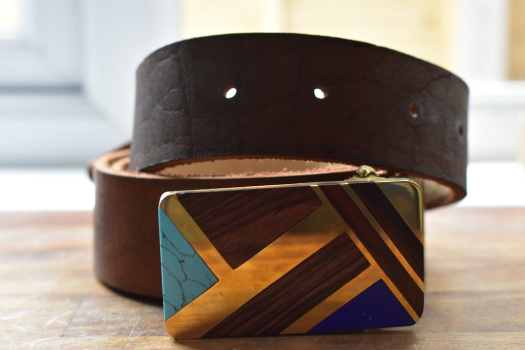 custom brown belt with art buckle