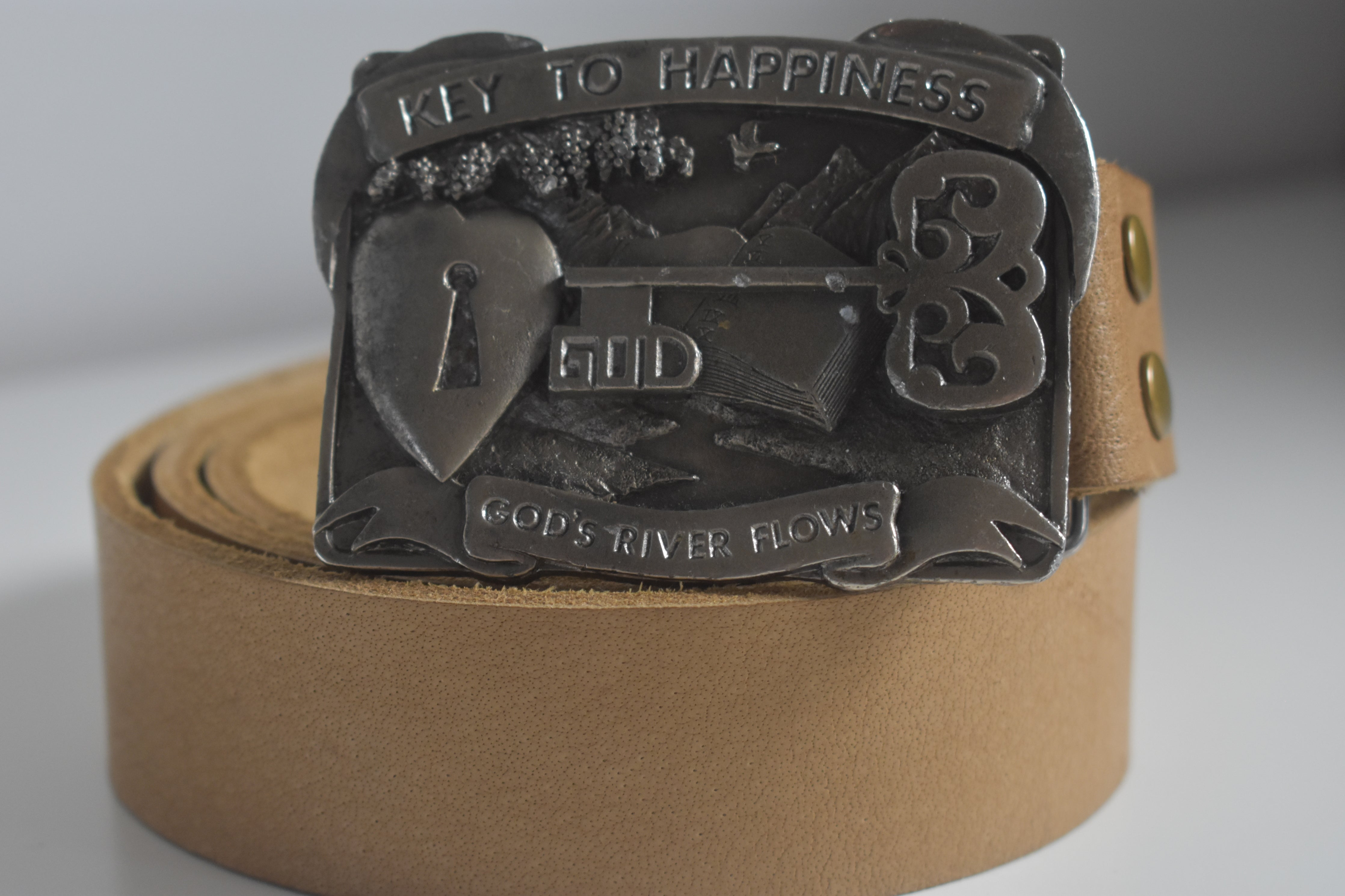 Custom Belt Buckles Key to Happiness