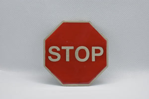 custom belt buckle stop sign