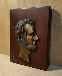 Vintage ABRAHAM LINCOLN HEAD on WOOD PLAQUE ~ Copper Tone Bronze or Brass Metal