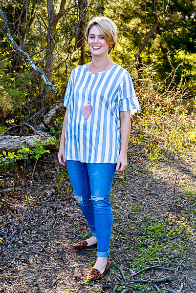 Striped shirt with ruffle sleeves and peek a boo back