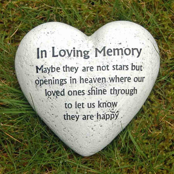 'In Loving Memory' heart shaped memorial block on grass