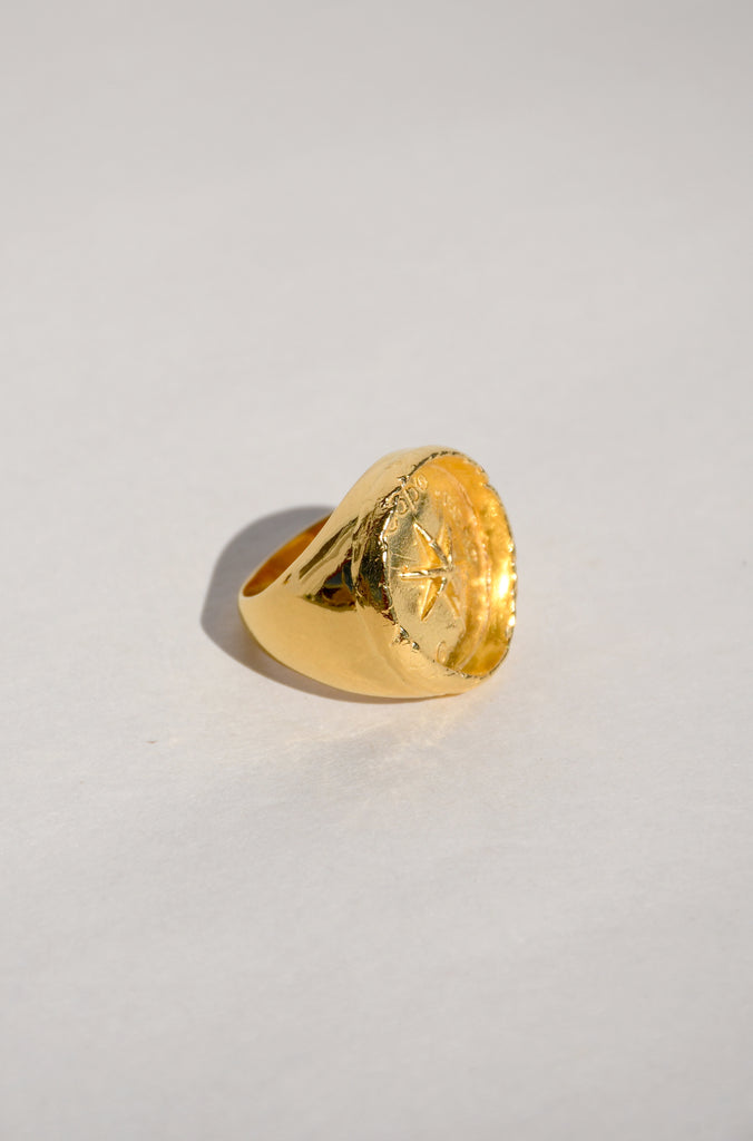 GOLD STARBURST SIGNET RING