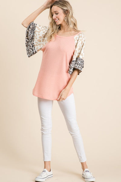 Blush knit top with leopard bell sleeves