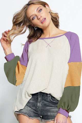 Ivory waffle knit top with color detail sleeves