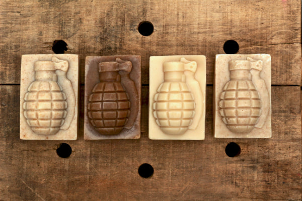4 pack of grenade soap on wood background