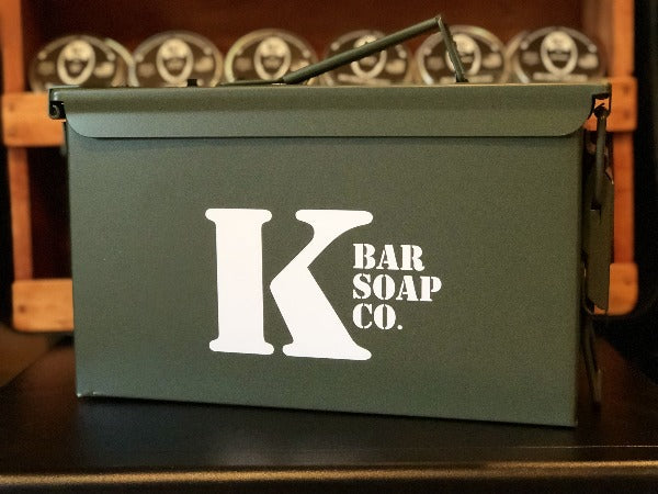 .50 Cal Ammo Can with K Bar Logo and Shelf of Beard Grease Behind it