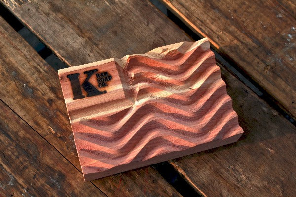 Cedar flag soap dish on wood background