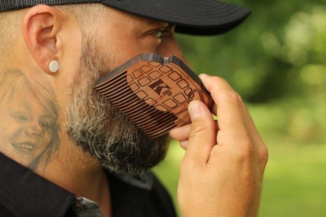 Man using K Bar beard comb