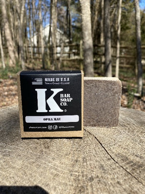 K Bar Opha Mae Soap Bar in black packaging with logo