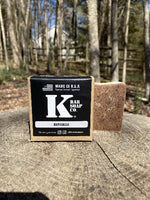 K Bar Reveille Soap Bar in black packaging with logo