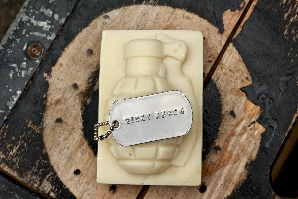 Ricky Recon Grenade Soap with dog tag on top of wood