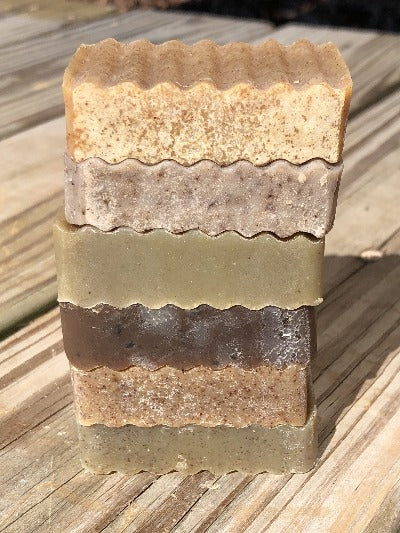6 bars of natural soap stacked outside on deck